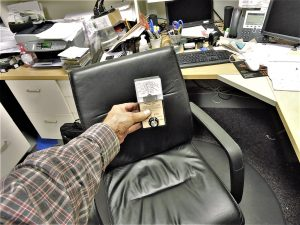 EMF radiation exposure at office desk shown with a meter