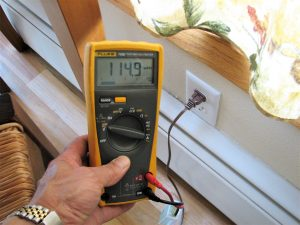 EMF radiation exposure from home wiring shown with a meter