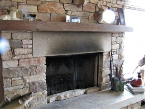 Soot stains above fireplace opening indicate contaminated indoor air